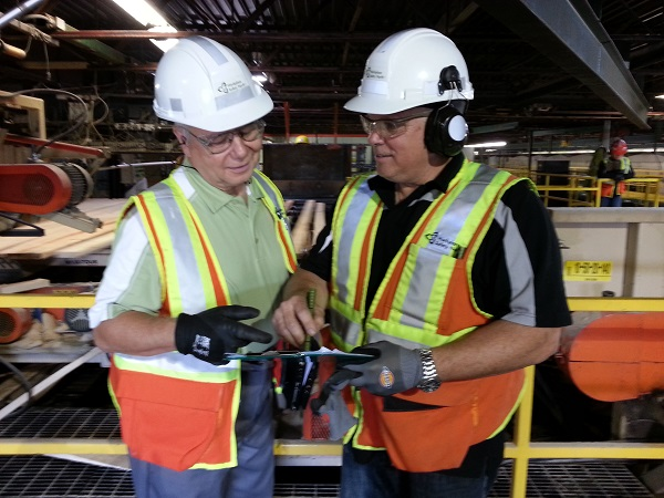 Two health and safety specialists consult at worksite