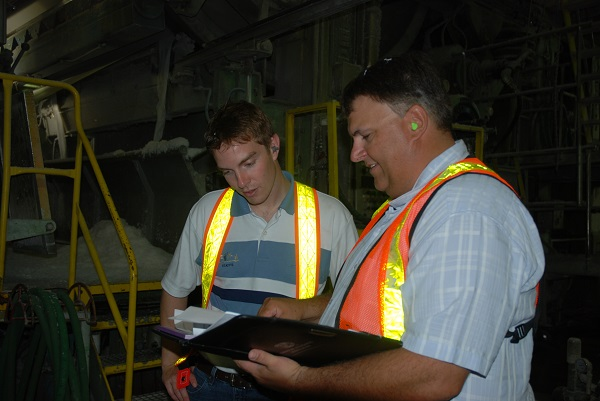 Two workers in manufacturing facility