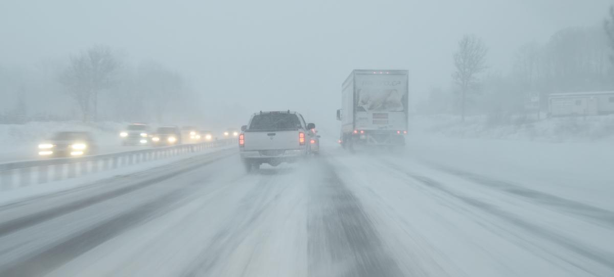 Trucks and cars on snowy highway