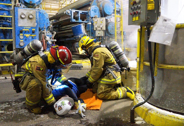 Firefighters assist unconscious victim