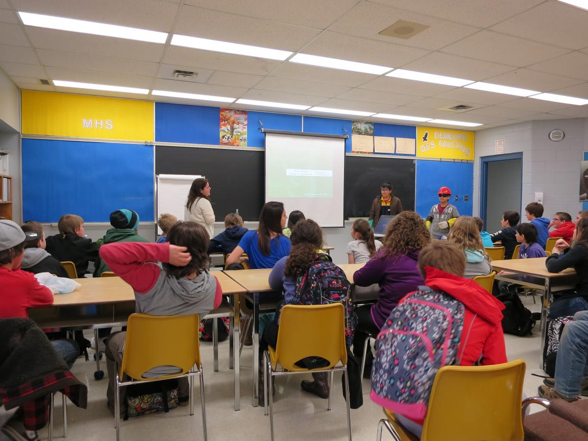 safety lesson during career exploration day workplace safety north teacher in a classroom of middle school students
