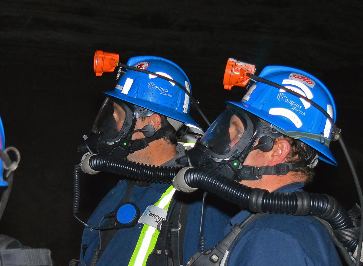 Two mine rescue officers wearing test facemask