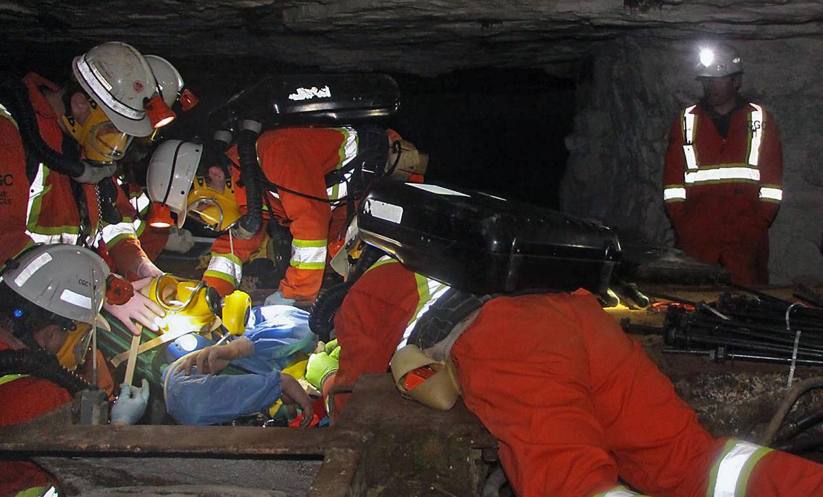 Mine rescue workers at underground fire drill