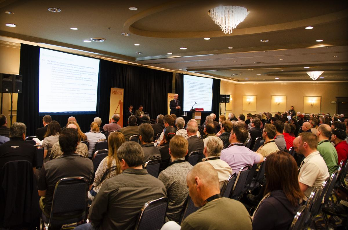 Group of 300 attendees at opening remarks presentation for mining conference