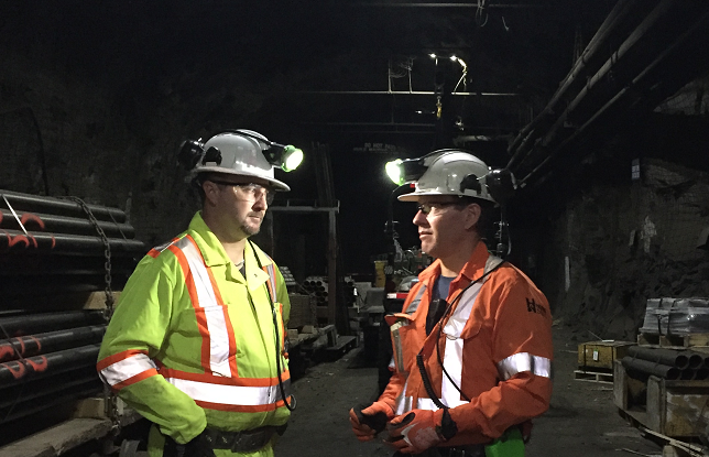 Two miners talking