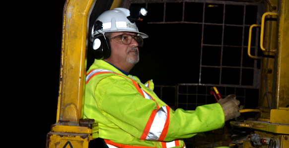 Underground mine worker wearing high visibility safety apparel