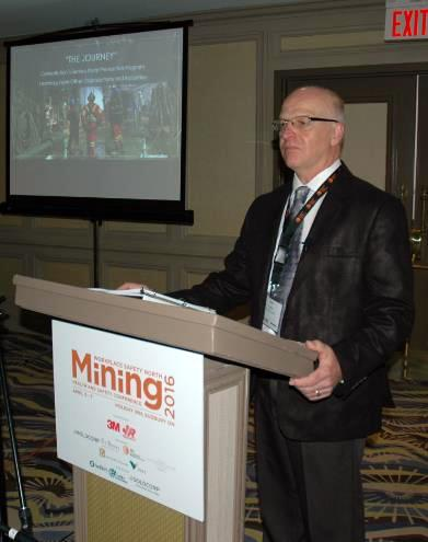 Mining conference speaker Ray Fortin at podium