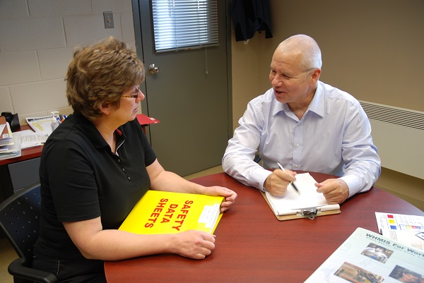 WSN health and safety specialist Dan Suess consults with client