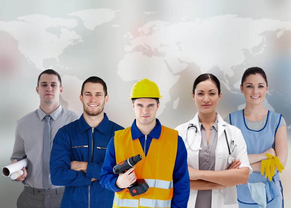 Variety of workers standing in front of global map
