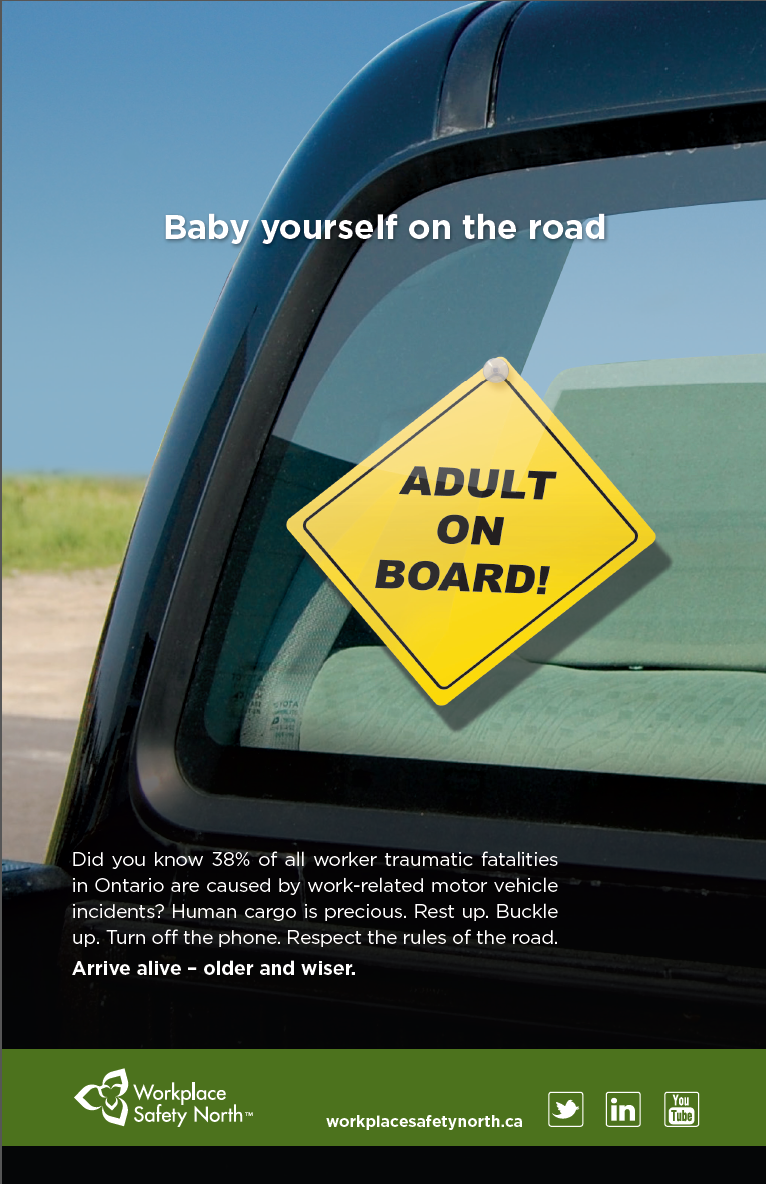 Truck window with 'Adult on Board!' sign