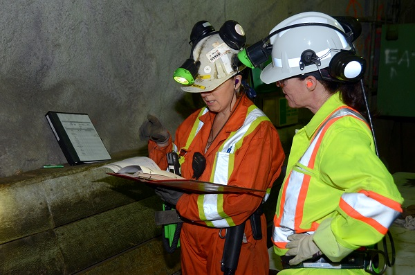 Two underground miners talking
