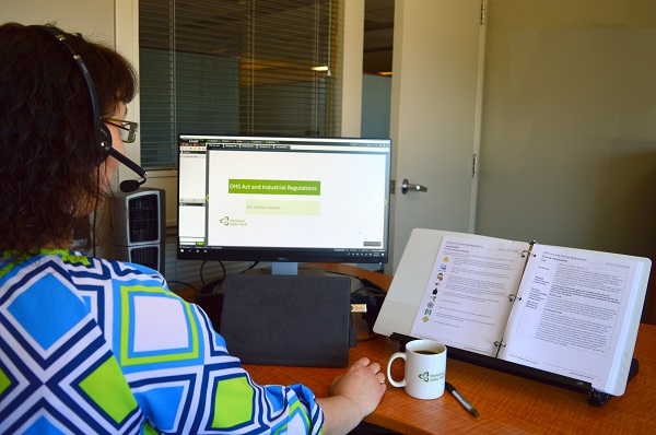 Woman sitting at desk with computer monitor screen
