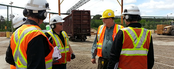Workplace Safety North health and safety specialists conducting an on-site consultation