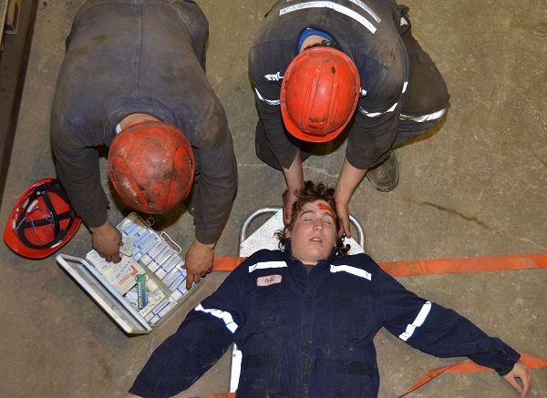 Injured young worker on stretcher